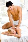 Couple making massage Stock Image