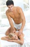 Couple making massage Stock Images