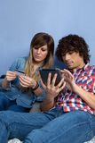 Couple making online purchase with tablet stock image