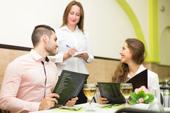 Couple making order in cafe Royalty Free Stock Photos