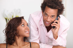 Couple with phone Stock Photos