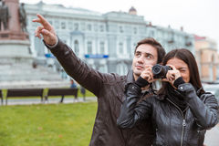 Couple making photo on camera outdoors Royalty Free Stock Image