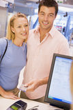 Couple making purchase with credit card. In store Royalty Free Stock Photos