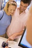 Couple making purchase in store Stock Photo
