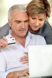 Couple making purchases on the Internet royalty free stock photography