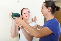Couple making repairs in the apartment Royalty Free Stock Image