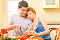Couple making salad at home. Young happy couple making salad at home Royalty Free Stock Photo