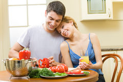 Couple making salad at home Royalty Free Stock Image