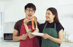 A couple is making salmon steak stock images