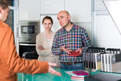 Couple making scandal at kitchen store Royalty Free Stock Image