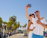 Couple making selfie by camera over venice beach Stock Photography