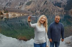 Couple making selfie at the lake Royalty Free Stock Photo