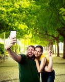 Couple making selfie in the park Royalty Free Stock Photos