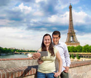 Couple making the selfie photo in Paris. Happy couple taking selfie picture in the travel in Paris France with the eiffel tower in the background stock photos
