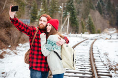 Couple making selfie photo on railway Royalty Free Stock Image