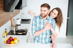 Couple making selfie photo on smartphone at the kitchen Stock Photos