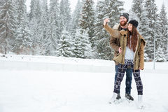 Couple making selfie photo on smartphone outdoors Stock Photo