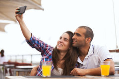 Couple making selfies Royalty Free Stock Photography
