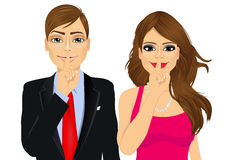 Couple making silence or secret hand gesture Royalty Free Stock Photo