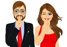 Couple making silence or secret hand gesture Royalty Free Stock Photography
