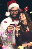 Couple making a toast at New Year`s party royalty free stock photo