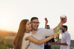 Couple making a toast at a party royalty free stock photo