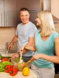 Couple making vegetable salad Stock Images