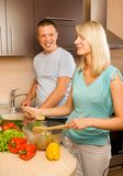 Couple making vegetable salad royalty free stock image