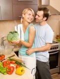 Couple making vegetable salad Stock Photo