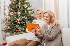 Couple making video call on christmas Stock Image