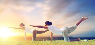 Couple making yoga balancing table pose outdoors Royalty Free Stock Photo