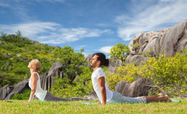 Couple making yoga cobra pose outdoors Royalty Free Stock Photo