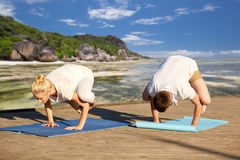 Couple making yoga crow pose outdoors Stock Images