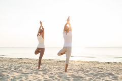 Couple making yoga exercises outdoors from back Stock Photos