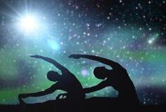 Couple making yoga exercises over space background Stock Image