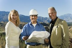 Couple With Male Architect At Construction Site Royalty Free Stock Images