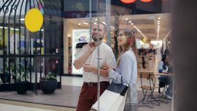 Man and woman talking in a mall stock video footage