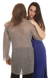 Couple man chain mail woman look over his shoulder Royalty Free Stock Photo