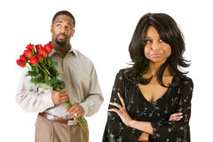 Couple: Man With Flowers to Apologize royalty free stock photography