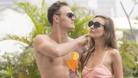 Couple of man and girl sexy in fashion underwear bikini sweet lo. Couple of men and girl sexy in fashion underwear bikini sweet love with beverage alcohol and Stock Photography