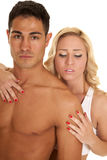 Couple man no shirt woman hand on his chest look down Royalty Free Stock Image
