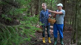 Couple man and woman argue to find way out from forest with smart phone gps