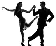 Couple man woman ballroom dancers tangoing. One  couple men women ballroom dancers tangoing in silhouette studio isolated on white background Royalty Free Stock Photography