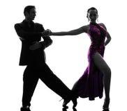 Couple man woman ballroom dancers tangoing  silhouette. One caucasian couple men women ballroom dancers tangoing in silhouette studio isolated on white Royalty Free Stock Photo