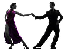 Couple man woman ballroom dancers tangoing  silhouette Royalty Free Stock Photos