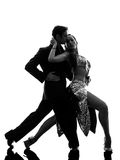Couple man woman ballroom dancers tangoing  silhouette Stock Photography