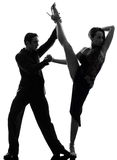 Couple man woman ballroom dancers tangoing  silhouette. One  couple men women ballroom dancers tangoing in silhouette studio isolated on white background Royalty Free Stock Photos