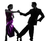 Couple man woman ballroom dancers tangoing  silhouette. One  couple men women ballroom dancers tangoing in silhouette studio isolated on white background Royalty Free Stock Photo