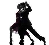 Couple man woman ballroom dancers tangoing  silhouette Stock Photography