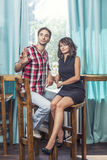 Couple man and woman in the bar with bacale Royalty Free Stock Image